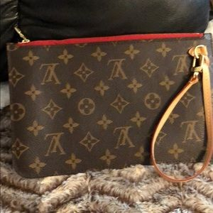 Brand new neverfull pouch